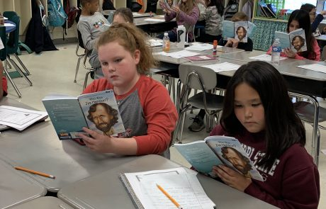 "Laney Whitt (left) and Lexi Fitzgerald, 4th grade students in Teresa Ohler's Language Arts class, read Who Was Jim Henson? as part of the ""Learning History through Literature"" project. Students are reading this book and making connections to famous Mississippians. The books were purchased through a school grant made possible by the Dean Provence Endowment for Excellence in Education."