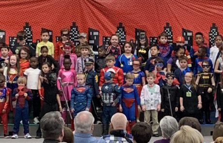 "First graders at New Albany Elementary School presented two performances of ""Everyday Superheroes"" on Friday, March 8. The program was about the qualities of everyday superheroes and how we all can be superheroes by exhibiting those qualities that we see in the heroes around us in our parents, first responders, doctors, nurses, and teachers just to name a few. First graders sang ""Superhero"", ""I'm Gonna Be"", ""If You Build It"", ""Intentional Life"",""We All Need Peace"", and ""Agents of Change""."